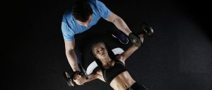 Personal Trainer working with a client.